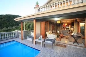 The swimming pool at or near Livingstone Villa