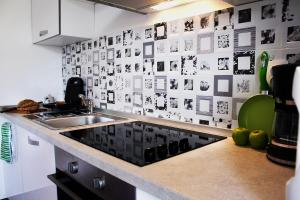 A kitchen or kitchenette at Apartments Lavel