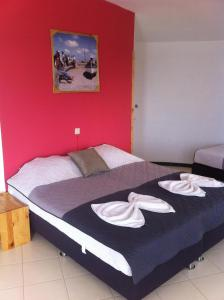 A bed or beds in a room at Questel BronQ