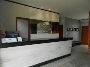 O saguão ou recepção de Splendore Hotel