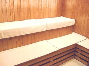 A bunk bed or bunk beds in a room at Dormy Inn Kitami
