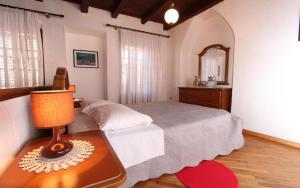 Кровать или кровати в номере Apartments Ive