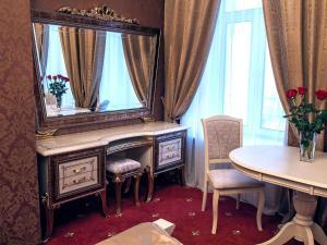 Телевизор и/или развлекательный центр в Piter Hotels