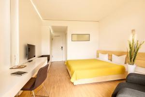 Ein Bett oder Betten in einem Zimmer der Unterkunft Midori - The Green Guesthouse