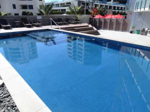 The swimming pool at or near The Pacific Apartments