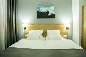 A bed or beds in a room at LivInn Hotel