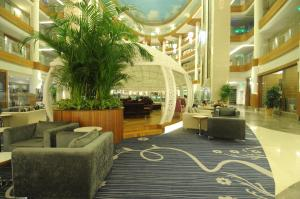 The lobby or reception area at Gold Island Hotel