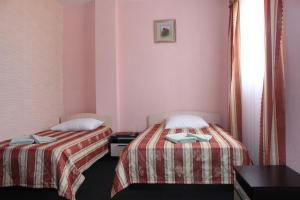 Кровать или кровати в номере Oasis Mini Hotel