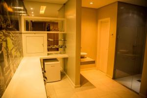 A kitchen or kitchenette at Motel Passione (Adult Only)