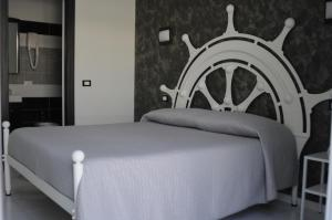 A bed or beds in a room at Badinomare