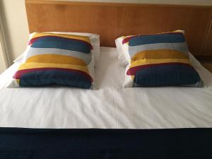 A bed or beds in a room at Hotel Ilha