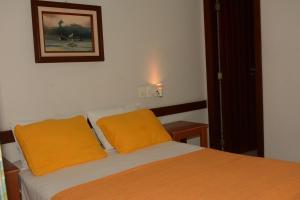 A bed or beds in a room at Pousada Paraíso Ilha Grande