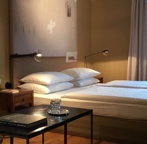 Ein Bett oder Betten in einem Zimmer der Unterkunft Strandhotel Margaretha
