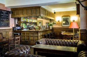 The lounge or bar area at The Angel Hotel