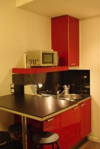 Een keuken of kitchenette bij Paris Apartment Concept