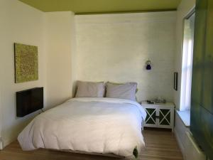 A bed or beds in a room at Le 253