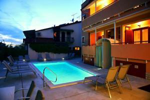 The swimming pool at or near Apartments Zdjelar