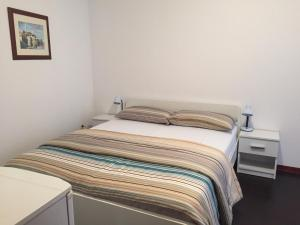 A bed or beds in a room at Boutique House Djaki