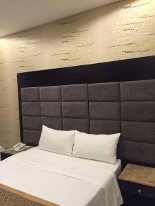 Cama ou camas em um quarto em Rukon Buotat 15
