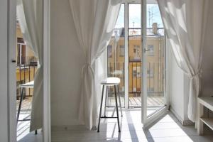 Балкон или терраса в RentalSPb white on Rubinsteina