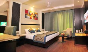 A bed or beds in a room at Hotel City Star