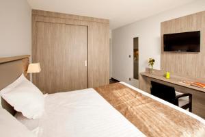 Un ou plusieurs lits dans un hébergement de l'établissement Séjours & Affaires Grenoble Marie Curie