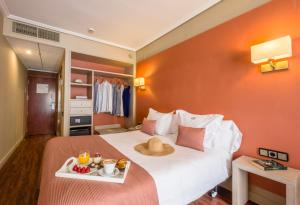 Cama o camas de una habitación en Regente Aragón Gastronómico