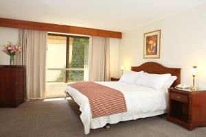 Cama o camas de una habitación en MR Hotel Providencia (ex Hotel Neruda)
