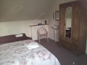 A bed or beds in a room at Norlaggan