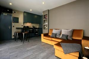 Area soggiorno di Charm Flats