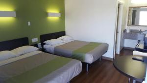 A bed or beds in a room at Motel 6-El Paso, TX - West