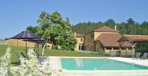 The swimming pool at or near Domaine du Champ de l'Hoste