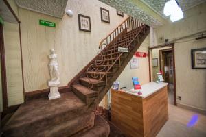The lobby or reception area at Hotel Sahara Inn