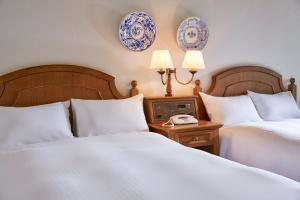 A bed or beds in a room at Miyako Resort Shima Bayside Terrace