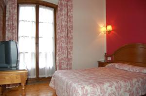Cama o camas de una habitación en Puente Romano