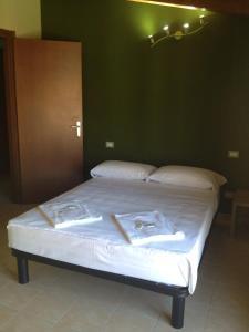 Postel nebo postele na pokoji v ubytování Milan Hotel
