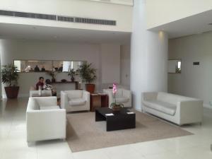 Uma área de estar em Flat no Coraçao de Brasilia