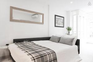 Säng eller sängar i ett rum på Victoria 16
