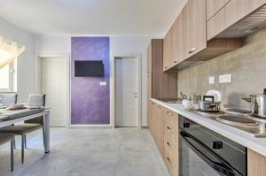 Kuchyň nebo kuchyňský kout v ubytování Central Suites