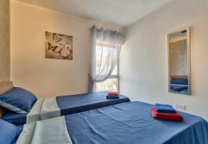 Postel nebo postele na pokoji v ubytování Central Suites