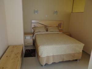 A bed or beds in a room at Hotel Piura Sol de Grau