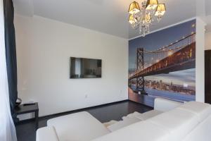 Телевизор и/или развлекательный центр в Apartment Apart Residence