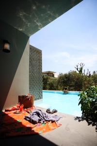 The swimming pool at or close to Proud Phuket Hotel