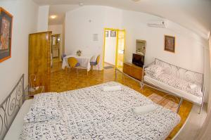 Krevet ili kreveti u jedinici u objektu Apartments Tomato 1