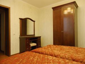 Кровать или кровати в номере Апарт-Отель Нагорное