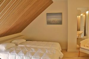 Un ou plusieurs lits dans un hébergement de l'établissement Villa Anita