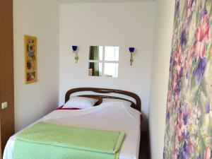 Кровать или кровати в номере Apartments in center