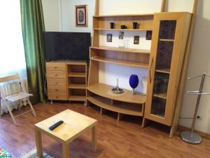 Телевизор и/или развлекательный центр в Apartments in center