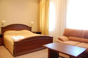 Кровать или кровати в номере HELIOPARK Residence