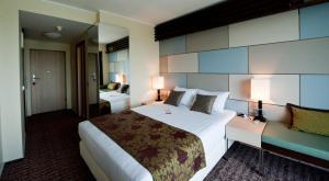 Ein Bett oder Betten in einem Zimmer der Unterkunft Atlas Hotel